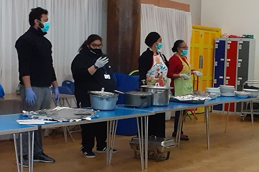 Neighbours in Poplar preparing to distribute hot meals