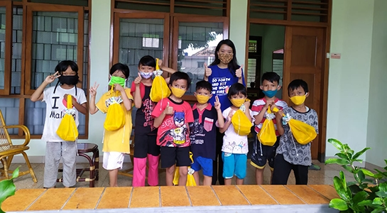 FCJ sisters in Yogyakarta Indonesia delivering gifts to village school children for Idul Fitri