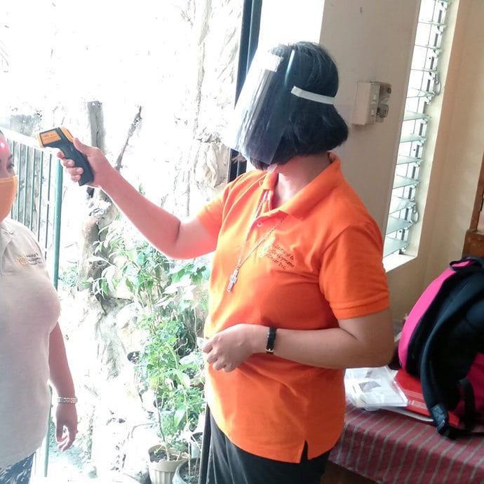 SR Ciony taking temperature of FCJ Center visitors